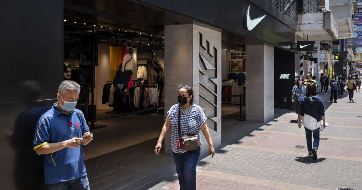 Nike shares surge more than 14%, hit record high as $50 billion sales outlook tops expectations